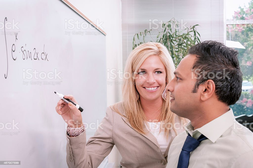 College/university students solving math problem - XII royalty-free stock photo