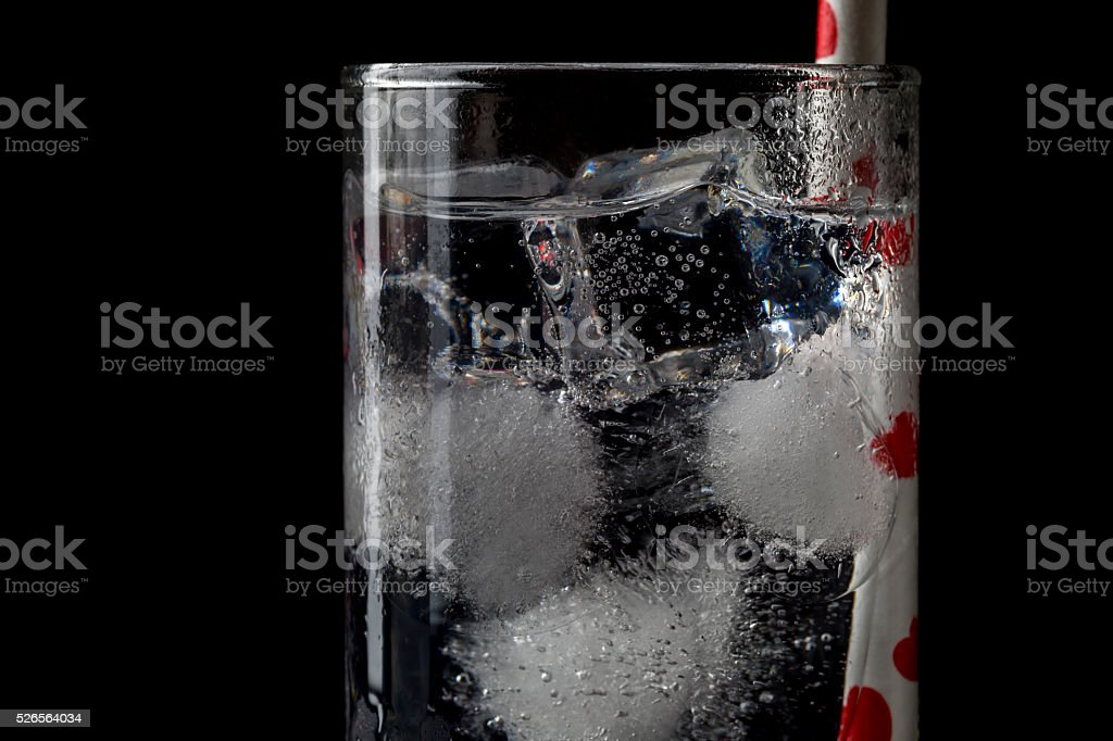 Collins glass with cocktails and colored straws. stock photo