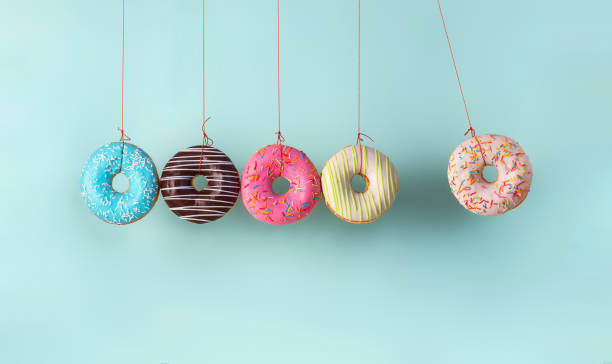 collision balls made from donuts - bombolone foto e immagini stock