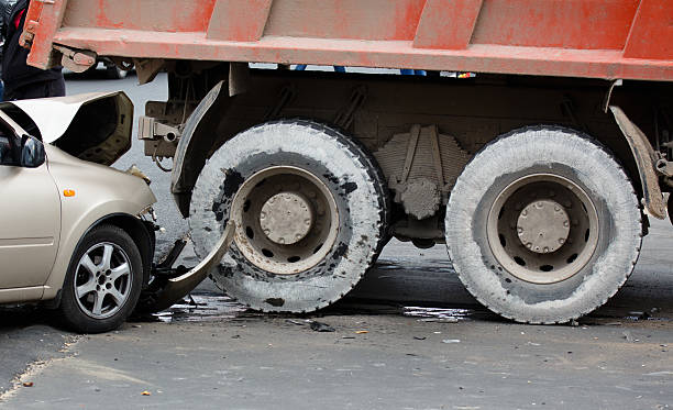 Collision. The accident on the road. Collision. The accident on the road. Passenger car crashed into a truck. commercial land vehicle stock pictures, royalty-free photos & images
