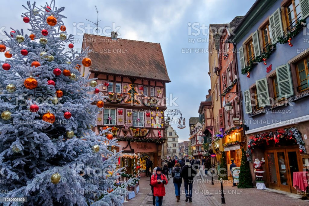 People strolling in the old town of Colmar decorated for the...