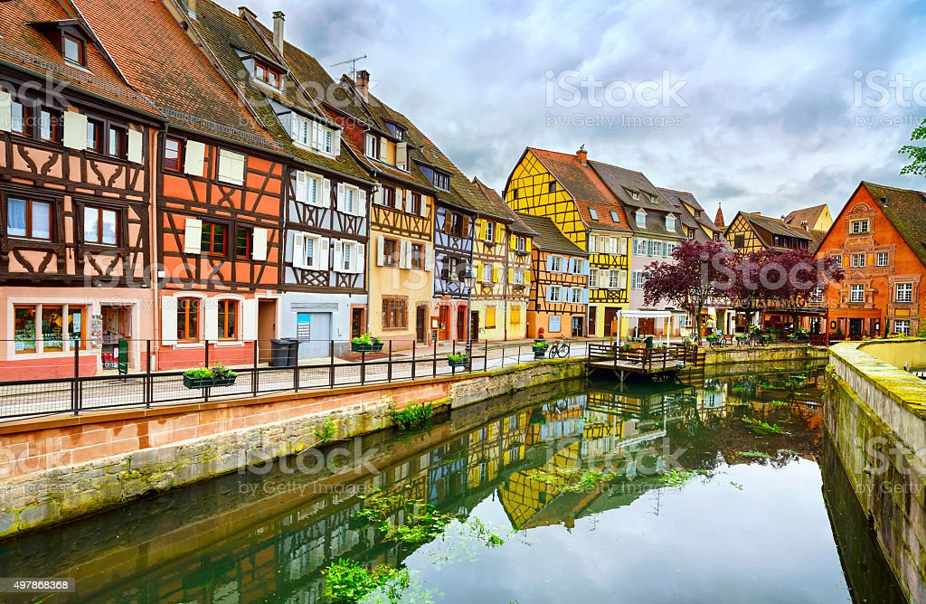 Colmar, Petit Venice, water canal and traditional houses. Alsace Colmar, Petit Venice, water canal and traditional colorful houses. Alsace, France. Long exposure. 2015 Stock Photo