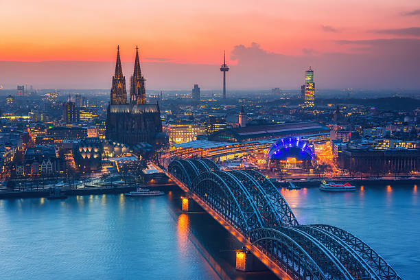 Cologne at dusk Aerial view on Cologne at night romanesque stock pictures, royalty-free photos & images