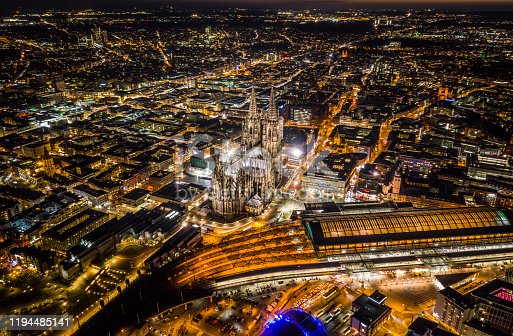 Aerial view of Cologne Cathedral and Cologne Central Station illuminated a night. Aerial view. Germany - Europe