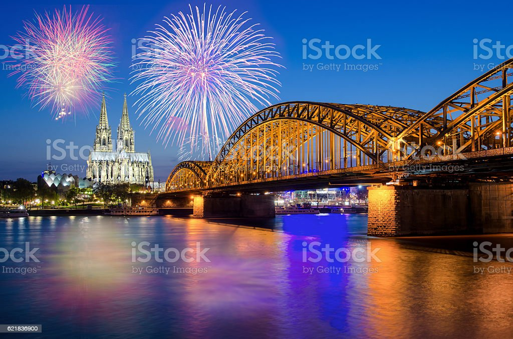 Cologne Cathedral and Hohenzollern Bridge with Fireworks stock photo