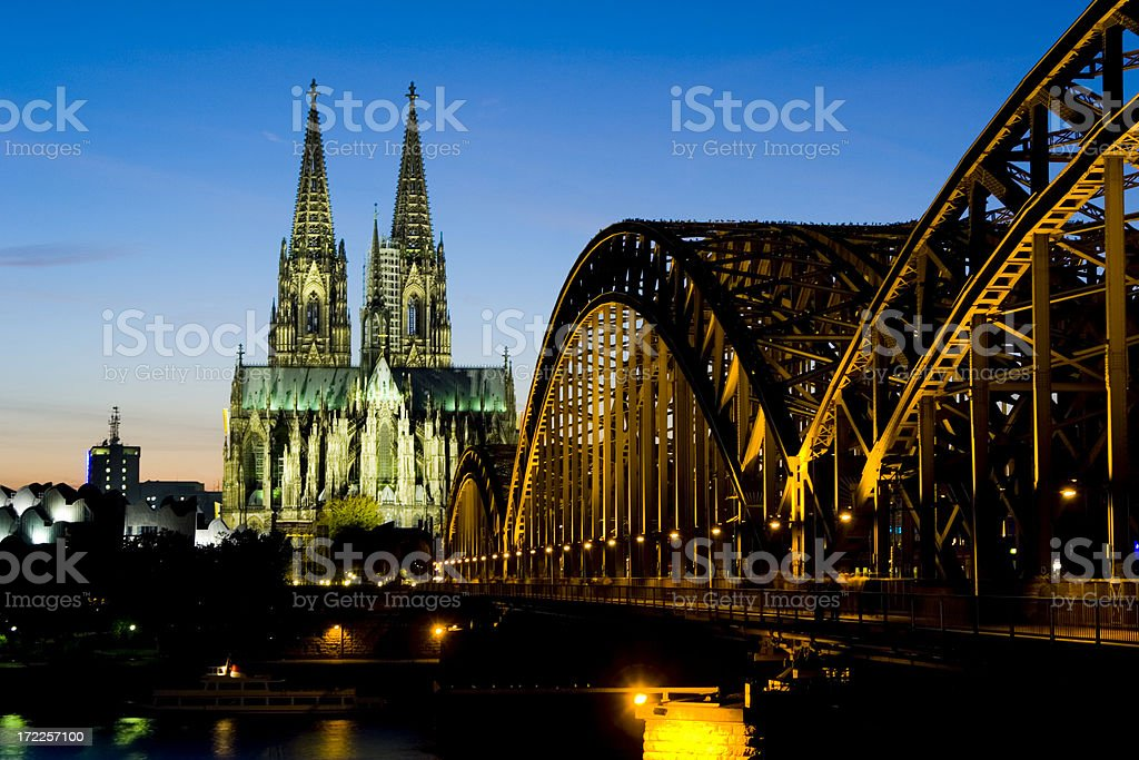 Cologne Cathedral and Hohenzollern Brigde in Twighlight royalty-free stock photo