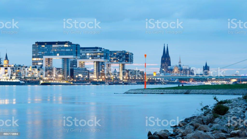 Cologne Cathedral and Rheinau Harbor (Rheinauhafen) at night stock photo