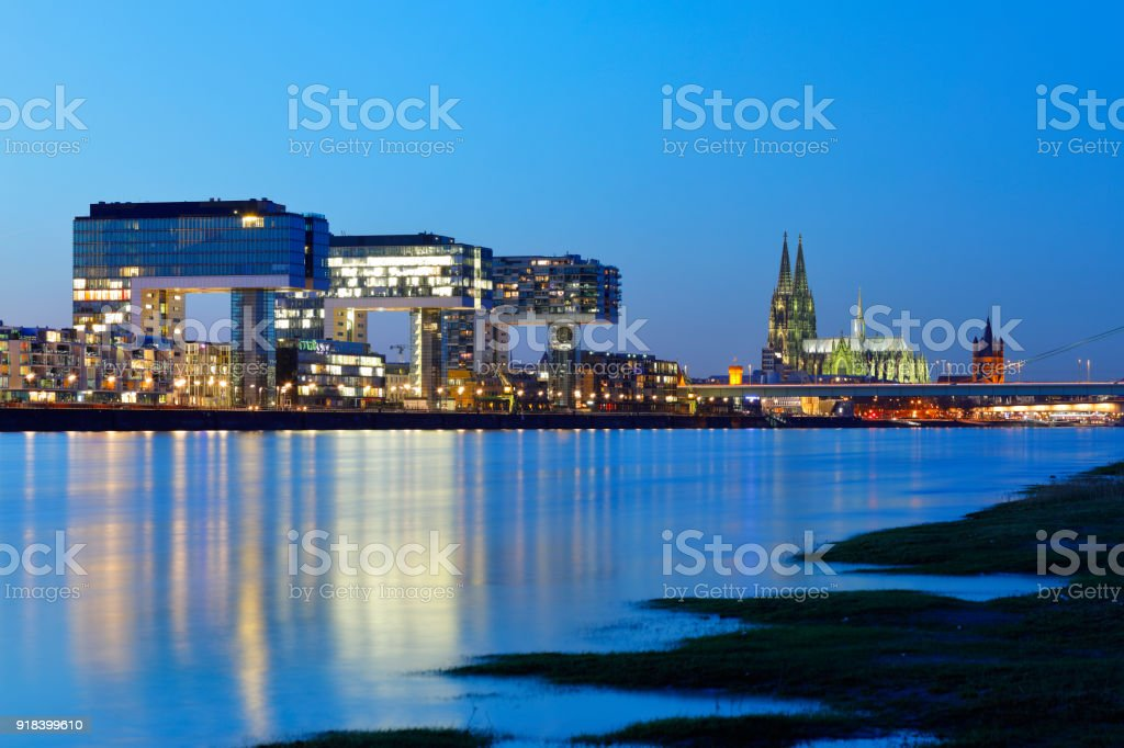 Cologne Cathedral and Rheinauhafen at night, Cologne, Germany stock photo