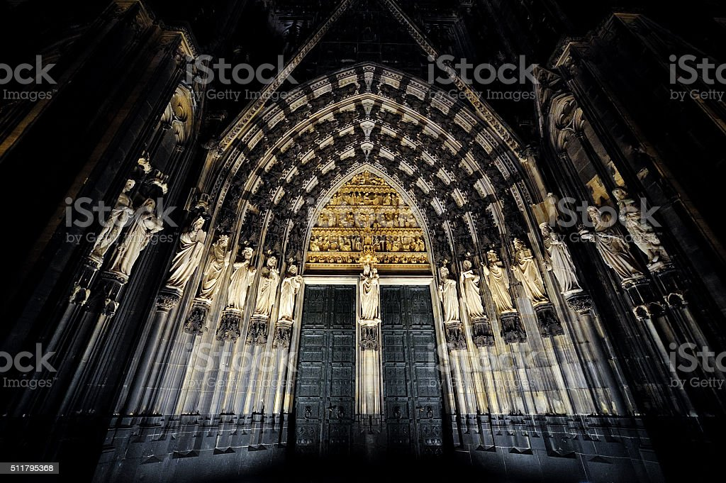 Cologne Cathedral entrance night stock photo