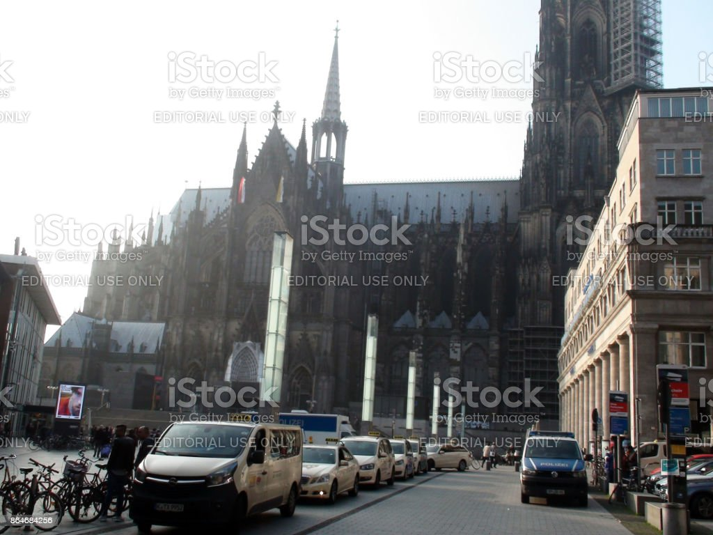 cologne cathedral germany police vehicle taxi stand and people scene in germany europe royalty