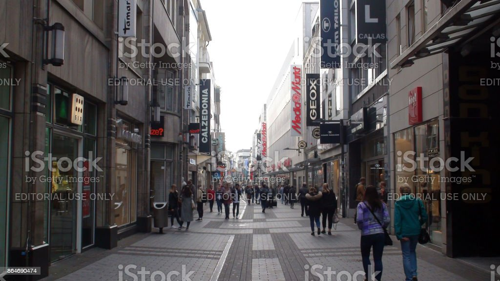 cologne city center shopping district plus people walking scene in germany europe royalty free stock
