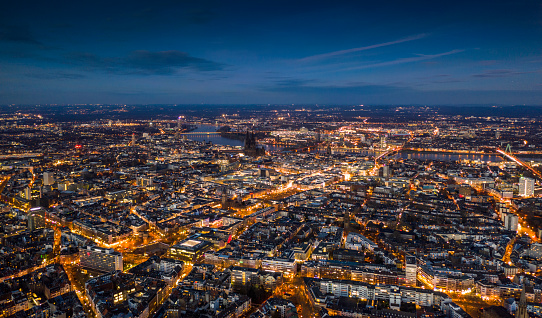 Aerial view of Cologne cityscape illuminated at dusk. Germany - Europe