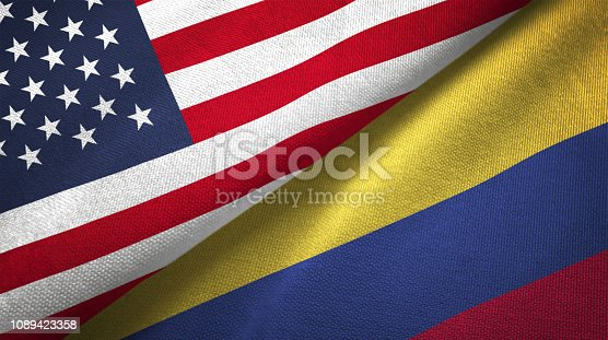 istock Colombia and United States two flags together realations textile cloth fabric texture 1089423358
