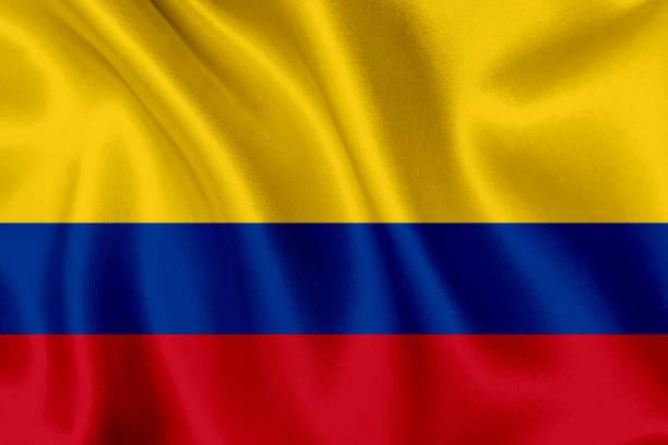 bandera de colombia ondeando fondo - bandera colombiana fotografías e imágenes de stock
