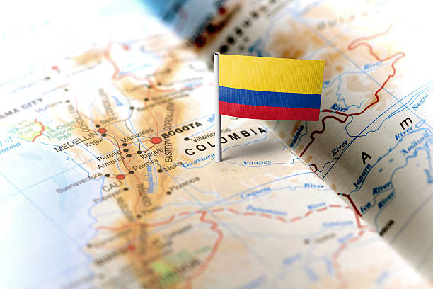 colombia pinned on the map with flag - colombia stock photos and pictures