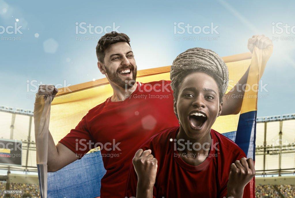 O atleta colombiano casal / ventilador celebrando no estádio - foto de acervo