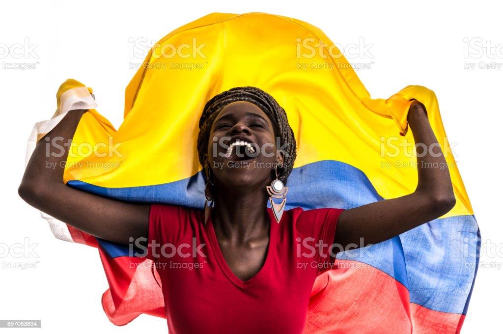 Fan colombiano / ecuatoriano / Venezolano celebra con la bandera nacional - foto de stock