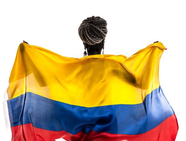 fan colombiano / ecuatoriano / venezolano celebra con la bandera nacional - bandera colombiana fotografías e imágenes de stock