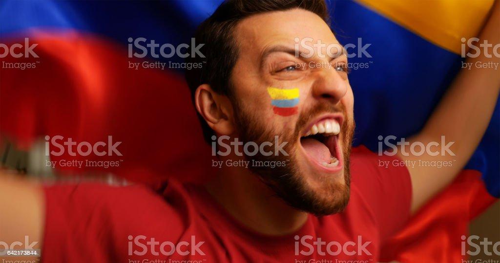 Colombian fan celebrating stock photo