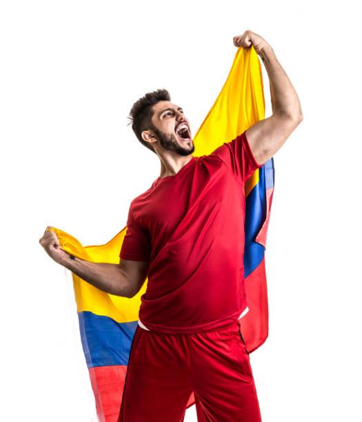 ventilador colombiano celebrar - bandera colombiana fotografías e imágenes de stock