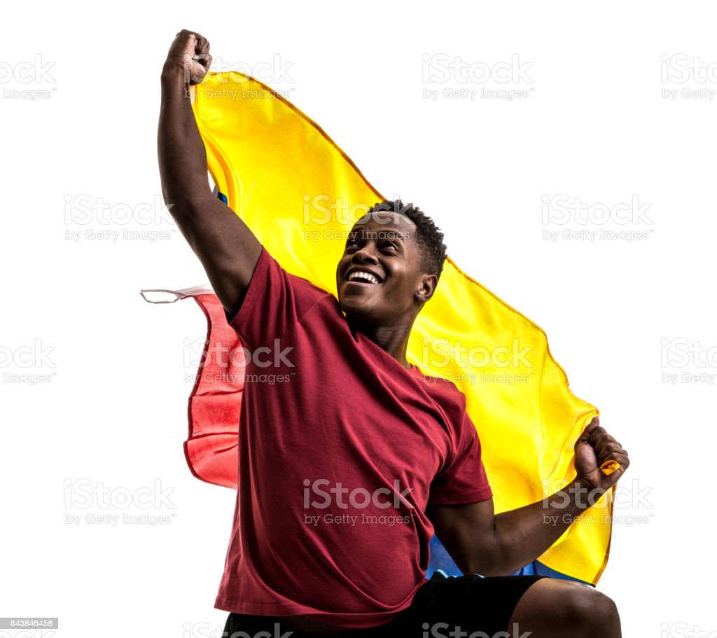 Fan colombiano / jugador del deporte celebra en fondo blanco - foto de stock