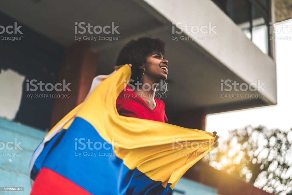 Colombian fan watching a soccer game stock photo