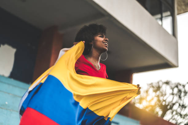 colombian fan watching a soccer game - colombia stock photos and pictures