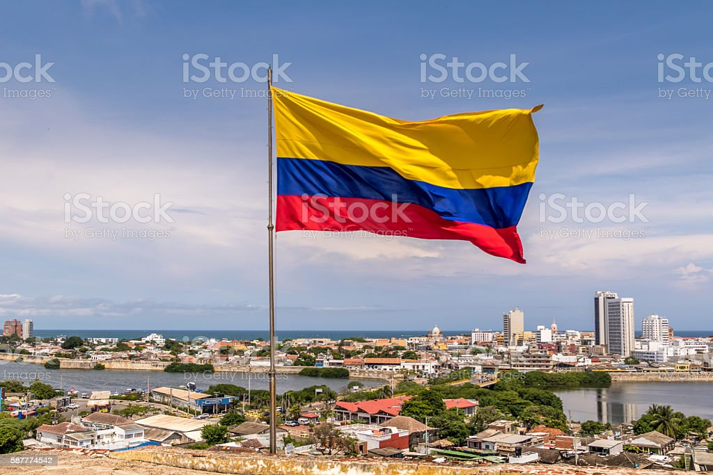 Colombian Flag over city of Cartagena, Colombia - foto de stock