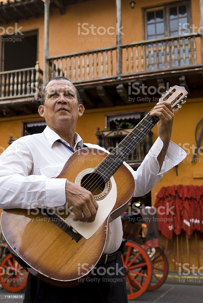 Street musician playing guitar in Cartagena, Colombia royalty-free stock photo