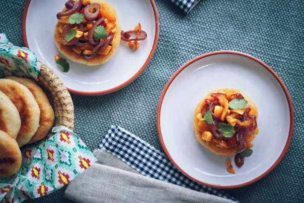 Colombian Vegetarian Arepas with Paprika, Corn, Tomato, Onion and Avocado stock photo