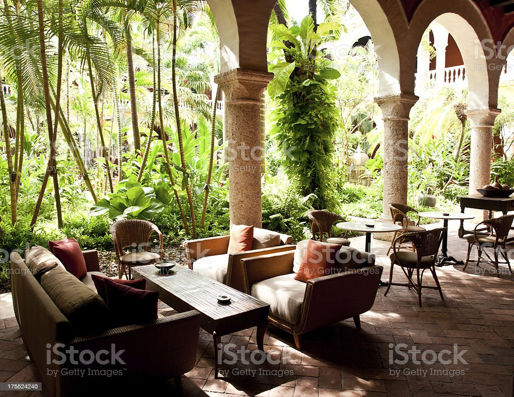 lush courtyard with tables around it