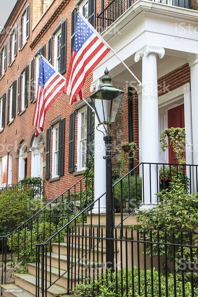 Colonial Brick Architecture with American Flags stock photo