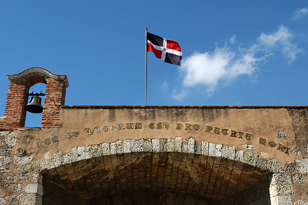 colonial building and national flag at Santo Domingo stock photo