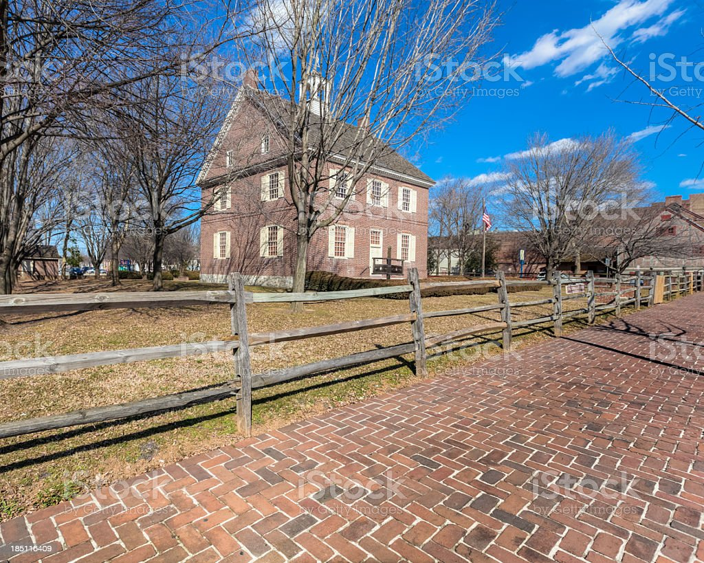 Colonial Court House With Brick Sidewalk and Rail Fence stock photo