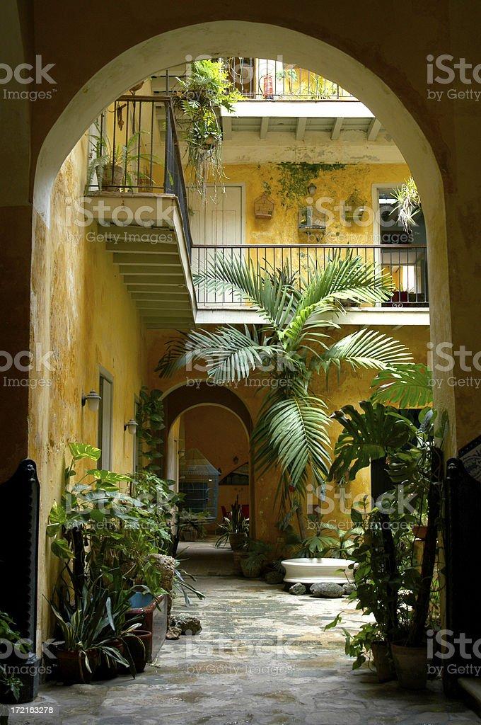 \'Glimpse of a vibrant Spanish colonial courtyard in Havana, Cuba\'