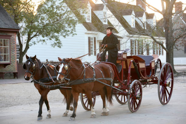 Colonial era horse drawn coach in Williamsburg, Va stock photo