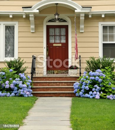Front entryway of Colonial home. FOR MORE HOUSES AND DOORS (CLICK