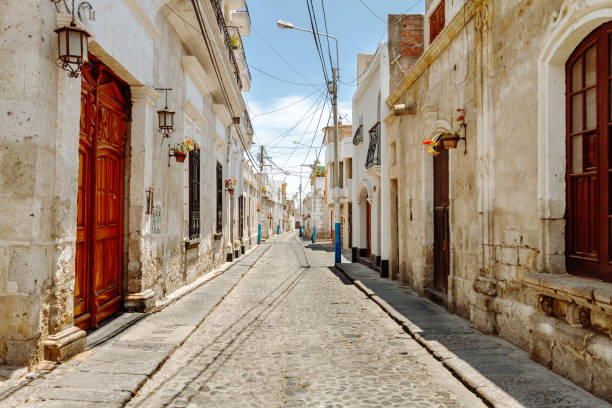 Colonial houses in an empty alley of the Yanahuara neighborhood in Arequipa (Peru) stock photo
