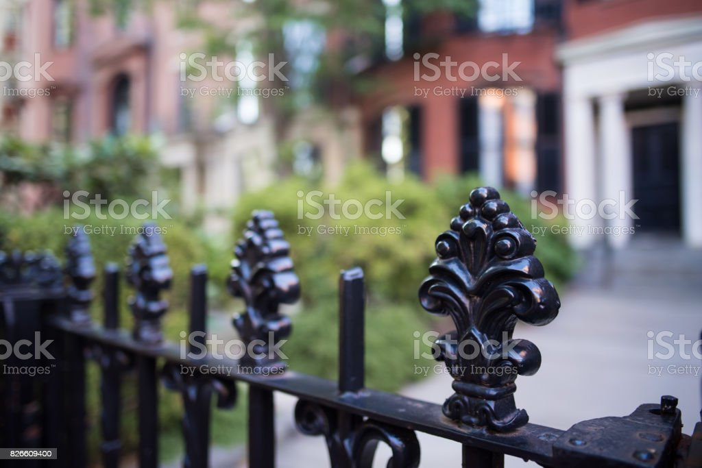 Colonial iron fence posts stock photo