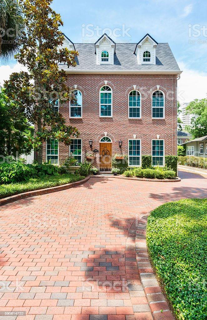 Colonial Style Home with a Brick Paver Driveway stock photo