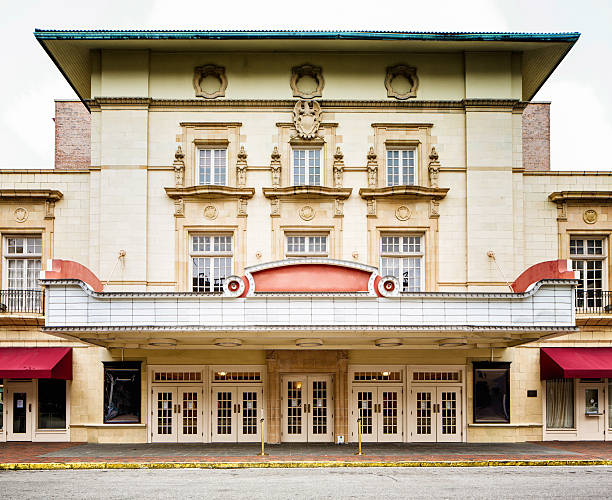 Colonial style southern USA movie theater concert hall facade Colonial style southern USA movie theater concert hall facade with curb and sidewalk. theater marquee commercial sign stock pictures, royalty-free photos & images