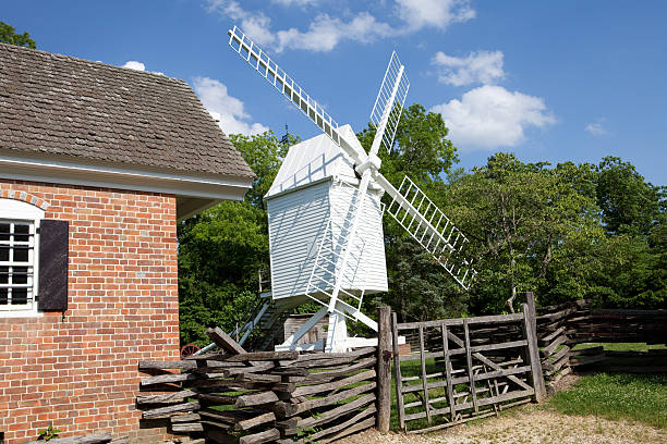 Colonial windmill stock photo
