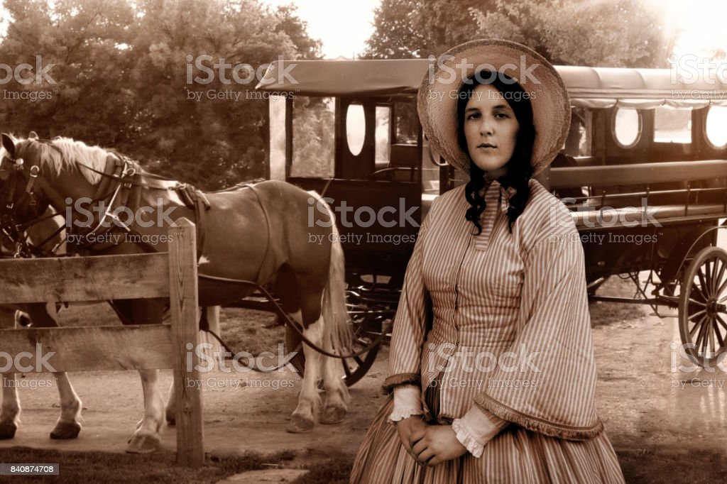 colonial woman and Amish carriage stock photo