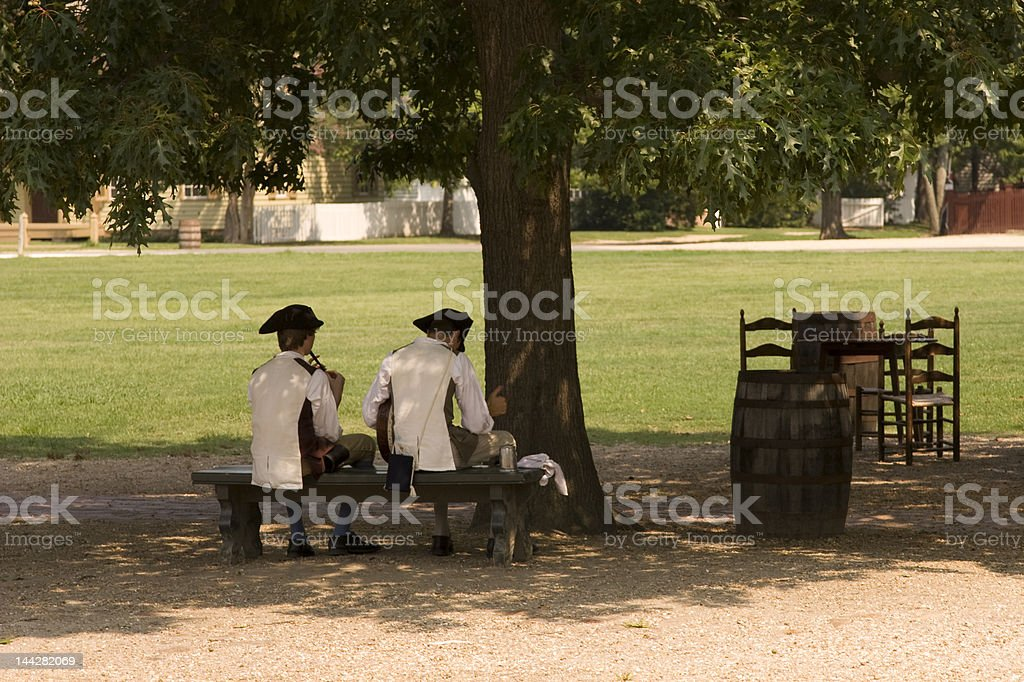 Colonials on a Bench stock photo