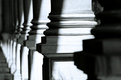istock Colonnade, black and white row of classical stone columns 1083053038