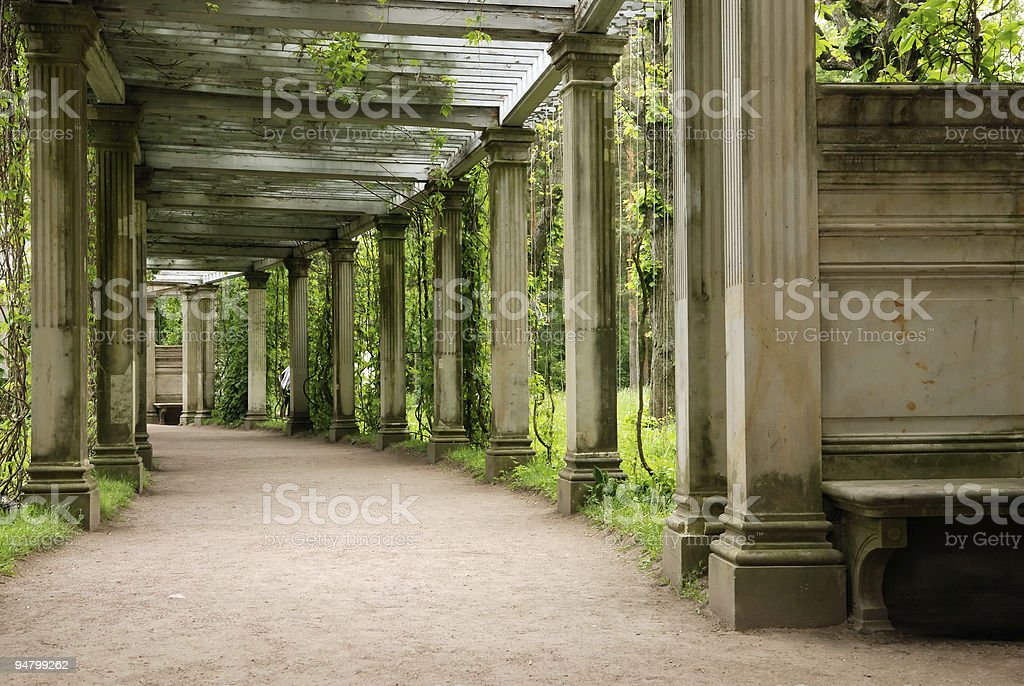 Colonnade in old park royalty-free stock photo