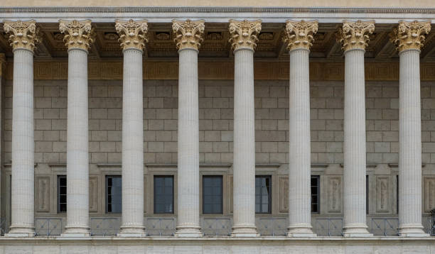 A colonnade of a public law court in Lyon, France. A neoclassical building with a row of corinthian columns. stock photo