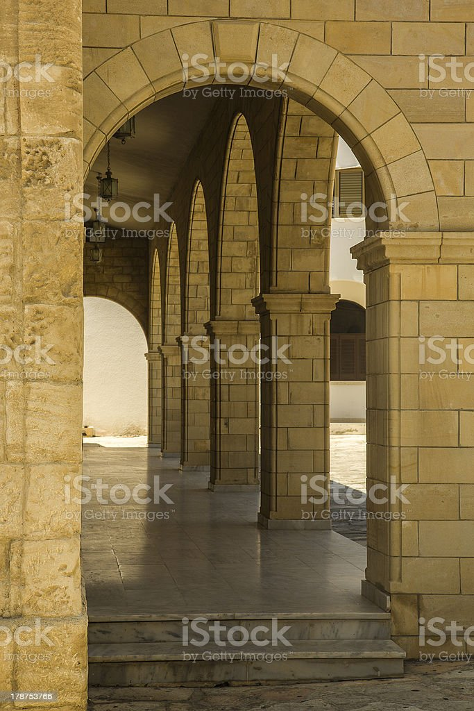 Colonnade with arch royalty-free stock photo