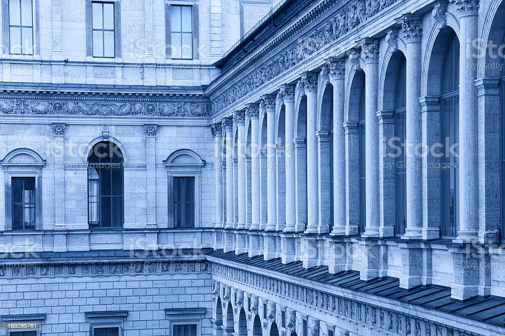 colonnade with old town house in blue royalty-free stock photo