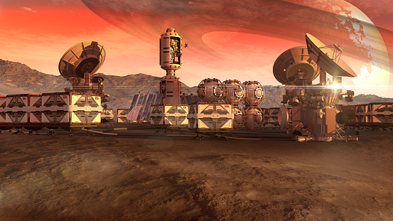 A colony on a Mars-like red planet, with crate pods, satellite dishes and a moon on a dusty sky, for planetary and space exploration backgrounds.
